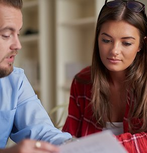 woman reviewing paperwork with financial aid advisor