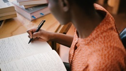 Photo of a student taking notes during a study session.