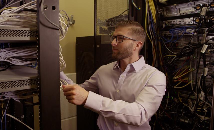 Man working on rack in server room