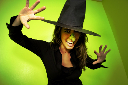 Smiling woman wearing witch's costume