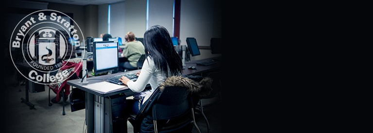 Students taking a computer course