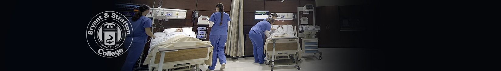 Nursing students evaluating patients
