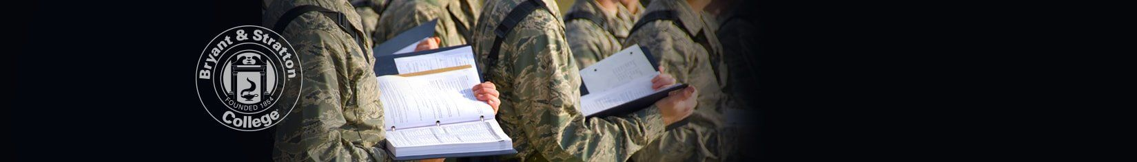 Military students reading textbooks