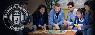 Students playing board game in dorms