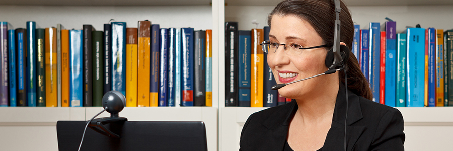 Online teacher talking to a student through a headset