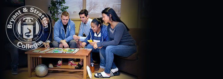 Students playing a board game at the dorms