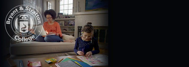 Mother taking Online classes at home with daughter