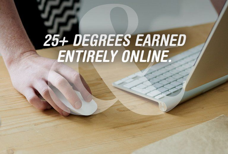 25+ Degrees Earned Entirely Online. Hand using computer mouse.