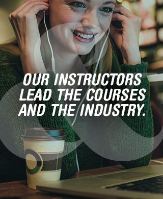 Our Instructors Lead the Course and the Industry. Woman at computer putting in earbuds.