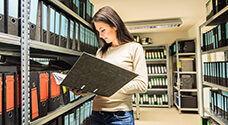 File Clerk reviewing records in the Medical Records stack