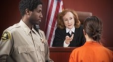 Judge and Bailiff in a courtroom