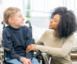 Occupational therapiy assistant working with a child in a wheelchair