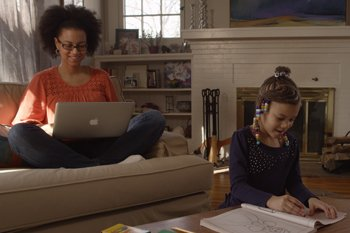 Mother Doing Online Classes At Home With Daughter